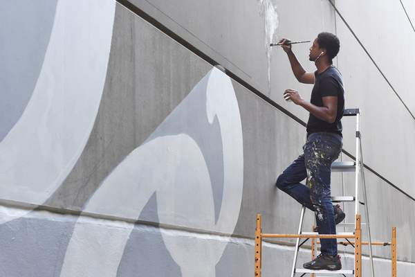 Rachel Von Stroup | The Journal Gazette Mural Artist Shawn Dunwoody works on a mural for Art This Way at 840 S. Calhoun St. in downtown Fort Wayne, IN on Thursday September 19, 2019. He is expected to continue painting through Sept. 24, including live painting during Art This Way's Art Crawl fundraiser Sept. 20.
