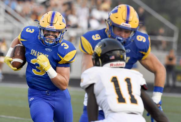 Homestead's Jake Archbold runs  toward to the end zone during the first quarter of Friday's home game against Snider. Archbold had 58 receiving yards and a touchdown in the win. (Rachel Von Stroup | The Journal Gazette)