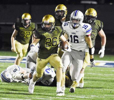Rachel Von Stroup | The Journal Gazette Bishop Dwenger's Louis Tippmann looks for running room during the third quarter of Friday night's game against Carroll at Shields Field.