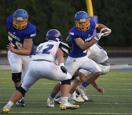 Katie Fyfe | The Journal Gazette East Noble junior Justin Marcellus runs down the field with the ball during the first quarter at East Noble High School on Friday.