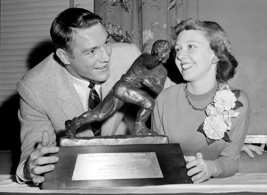 """Associated Press  Ohio State All-American Howard """"Hopalong"""" Cassady and his wife, Barbara, pose with the Heisman Trophy in 1955."""