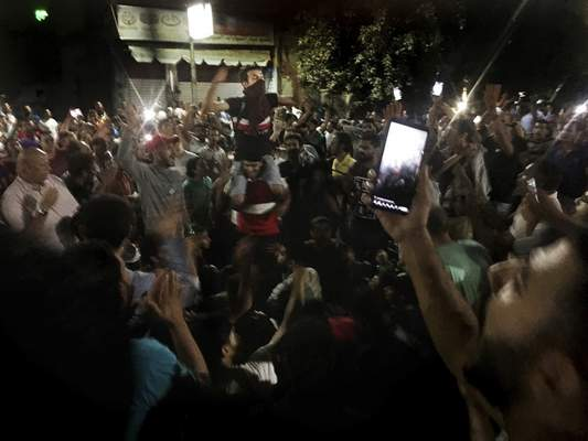 Protesters chant slogans against the regime in Cairo, Egypt, early Saturday, Sept. 21, 2019. (AP Photo/Nariman El-Mofty)