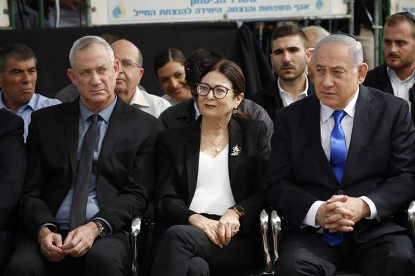 In this Thursday, Sept. 19, 2019 file photo, Blue and White party leader Benny Gantz, left, Esther Hayut, the Chief Justice of the Supreme Court of Israel, and Prime Minister Benjamin Netanyahu attend a memorial service for former President Shimon Peres in Jerusalem. (AP Photo/Ariel Schalit, File)