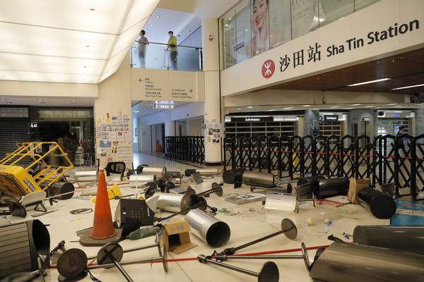 Protesters block the entrance to a subway station with debris Sunday, Sept. 22, 2019, in Hong Kong. (AP Photo/Kin Cheung)