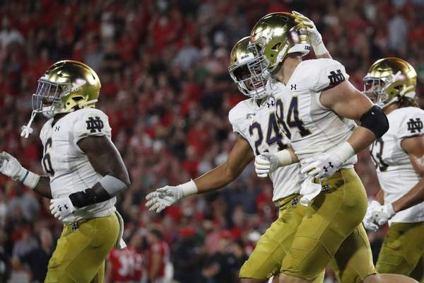 No. 10 Notre Dame faces 18th-ranked Virginia today at 3:30 p.m. at Notre Dame Stadium. The Cavaliers are looking for their first win against a top 10 team since 2005. (AP Photo/John Bazemore)