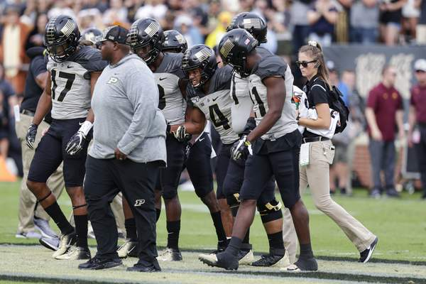 Associated Press Purdue wide receiver Rondale Moore, third player from right, is helped off the field Saturday in West Lafayette.