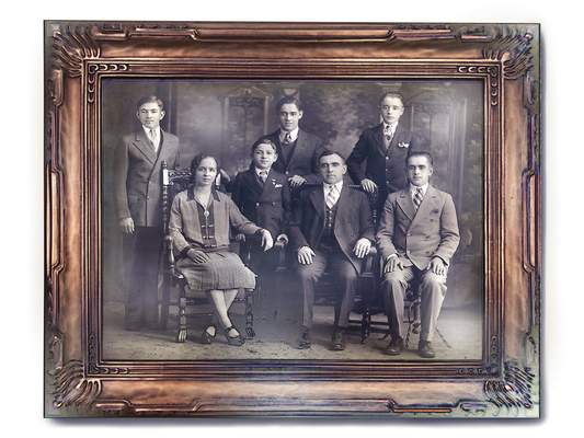 Courtesy photos A photo from the early 1930s shows Ronald Duchovic's grandmother, Josephine Gendjar, with her husband, Stephen Gendjar, her son and four stepsons. Duchovic's father, Julius, is standing at far right.