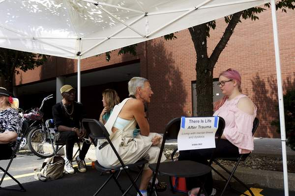 Anna Deabenstot stops to talk to Libby Smith, left, at The Human Library during Taste of the Arts in August. (Photos by Katie Fyfe | The Journal Gazette)