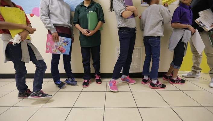 """Associated Press Migrant teens line up for a class at a private """"tender-age"""" facility for babies, children and teens, in Texas' Rio Grande Valley on Thursday."""