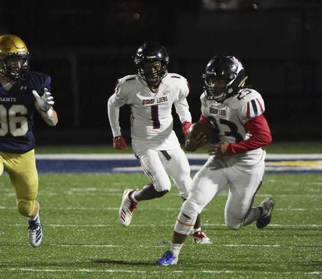 Katie Fyfe | The Journal Gazette  Bishop Luers junior CJ Hale runs the ball down the field during the second quarter against Bishop Dwenger at Shields Field on Friday.