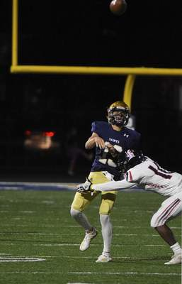 Katie Fyfe | The Journal Gazette  Bishop Dwenger junior Brenden Lytle passes the ball during the second quarter against Bishop Luers at Shields Field on Friday.