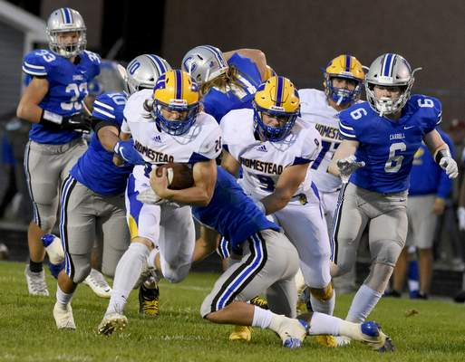 Homestead's Braeden Hardwick looks for extra yardage during Friday's SAC game at Carroll. (Rachel Von Stroup   The Journal Gazette)