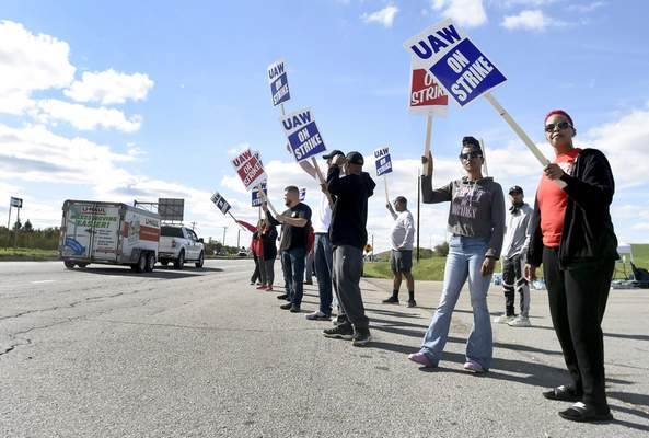 GM strikers including Marcie McKinney, far right, strike in front of GM Fort Wayne on Friday afternoon October 4, 2019.