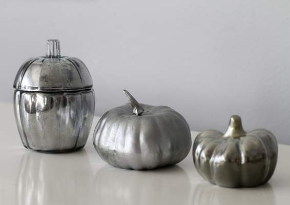 Associated Press  This Sept. 22, 2019 photo shows three faux mercury glass pumpkins displayed in Hopkinton, N.H. All were created using Krylon Looking Glass spray paint. The version on the left features a glass base, the middle pumpkin is made of foam and the the pumpkin on the right is made of ceramic. (AP Photo/Holly Ramer)