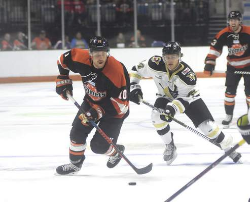 Katie Fyfe | The Journal Gazette  The Komets' Brady Shaw carries the puck while Wheeling Nailers' Willy Smith tries to stop him during the second period at Memorial Coliseum on Saturday.