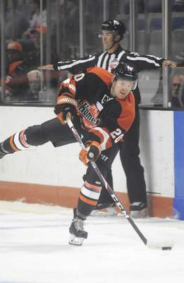 Katie Fyfe | The Journal Gazette  The Komets' Mason Bergh passes the puck during the first period against the Wheeling Nailers at Memorial Coliseum on Saturday.