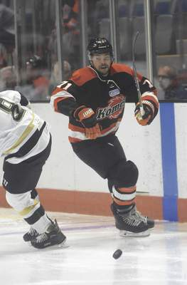 Katie Fyfe | The Journal Gazette  The Komets' Shawn St-Amant chases the puck during the third period against the Wheeling Nailers at Memorial Coliseum on Saturday.