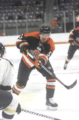 Katie Fyfe | The Journal Gazette Komets' Brett McKenzie attempts to shoot the puck during the first period against the Wheeling Nailers at Memorial Coliseum on Saturday.