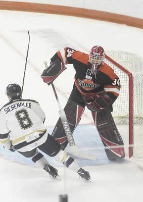 Katie Fyfe | The Journal Gazette Komets' Stephen Dhillon defends the goal during the first period against the Wheeling Nailers at Memorial Coliseum on Saturday.