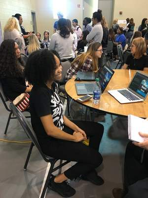 Lisa Green | The Journal Gazette  Alex Sejdinaj, co-founder of the South Bend Code School, set up laptops to help show high school students that coding may be easier than they imagined. She was the NEW workshop keynote speaker.