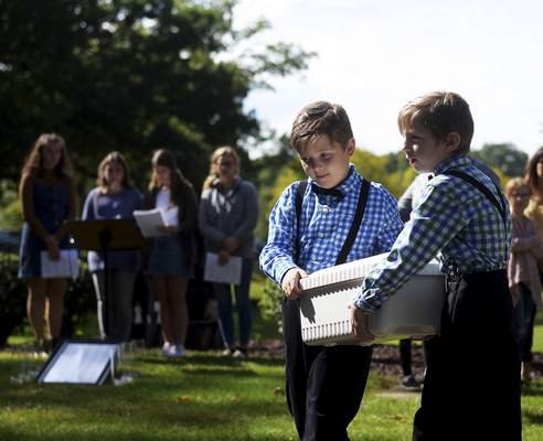 Ben and Teddy Maluchnik carry an empty casket at Sunday's Memorial for the Unborn.