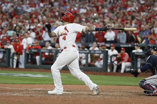 Associated Press  St. Louis Cardinals' Yadier Molina hits a sacrifice fly to score Kolten Wong for the winning run during the 10th inning in Game 4 of a baseball National League Division Series against the Atlanta Braves, Monday, in St. Louis.