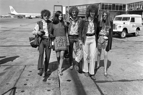 FILE - In this Aug. 20, 1967 file photo, members of the rock group Cream depart from Heathrow Airport in London, for their American tour. The trio, walking with unidentified female companions, from left are, base guitarist Jack Bruce, drummer Ginger Baker, and lead guitarist Eric Clapton. Baker, the volatile and propulsive British musician who was best known for his time with the power trio Cream, died Sunday, Oct. 6, 2019, at age 80, his family said. (AP Photo/Peter Kemp, File)