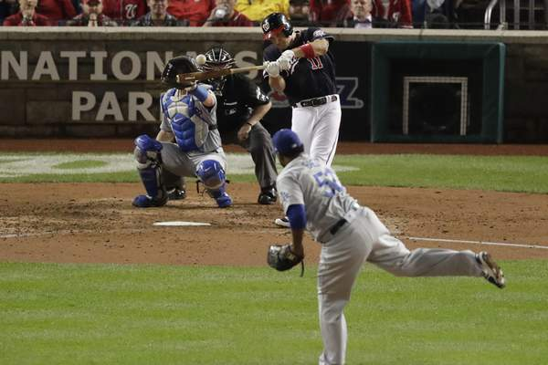 Associated Press The Nationals' Ryan Zimmerman hits a three-run home run off Dodgers relief pitcher Pedro Baez in the fifth inning in Game 4 of the NL Division Series on Monday.