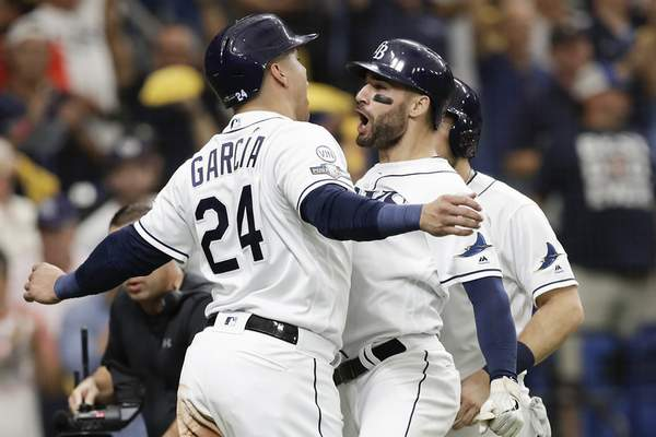 Associated Press photos The Rays' Kevin Kiermaier, right, celebrates his 3-run home run in the second inning of Game 3 of the AL Division Series against the Astros with Avisail Garcia. In all, Tampa Bay hit four home runs.