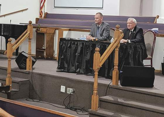 Mayor Tom Henry and Republican challenger Tim Smith debate Tuesday at True Love Missionary Baptist Church. (Dave Gong | Journal Gazette)