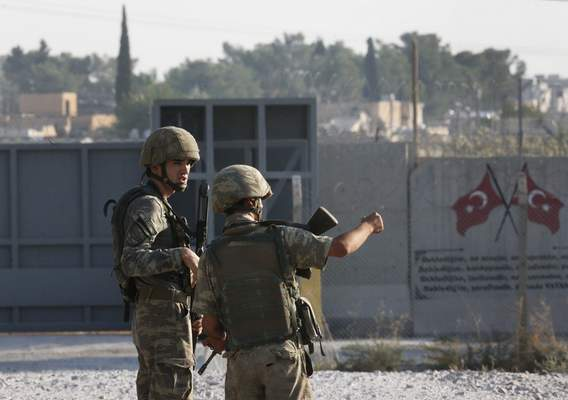 Shortly after the Turkish operation inside Syria had started, Turkish soldier stand at the border with Syria in Akcakale, Sanliurfa province, southeastern Turkey, Wednesday, Oct. 9, 2019. (AP Photo/Lefteris Pitarakis)