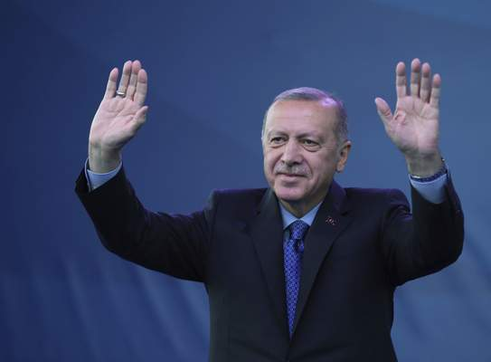 Turkey's President Recep Tayyip Erdogan waves as he attends a ceremony to inaugurate a Turkey-financed highway linking Belgrade with Bosnia's capital of Sarajevo in Sremska Raca, some 80 kilometers (49 miles) west of Belgrade, Serbia, during his two-day official visit, Tuesday, Oct. 8, 2019. (Presidential Press Service via AP, Pool)