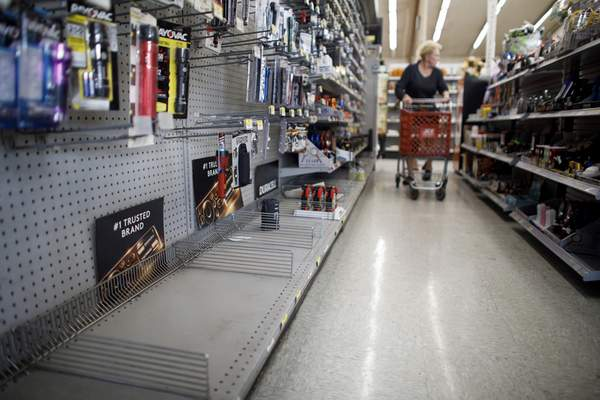 The lantern section is nearly empty at an ACE Hardware store as shoppers prepare for possible power shutoffs in Los Gatos, Calif., Tuesday, Oct. 8, 2019. (Dai Sugano/San Jose Mercury News via AP)