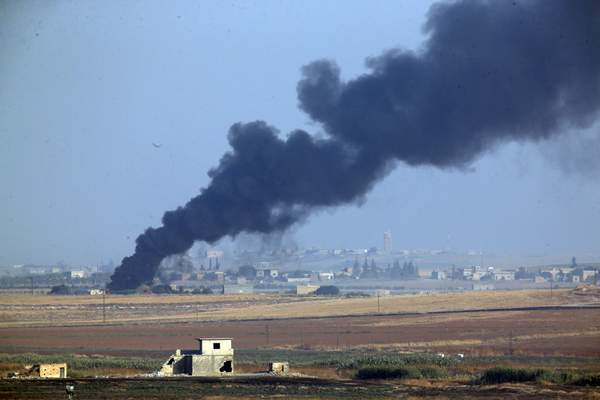 Associated Press Smoke billows from a fire inside Syria during bombardment by Turkish forces Wednesday from just across the border near Akcakale, Turkey.