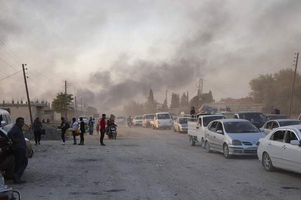 Associated Press Syrians flee shelling by Turkish forces in Ras al Ayn, northeast Syria, on Wednesday at the start of a Turkish military operation.