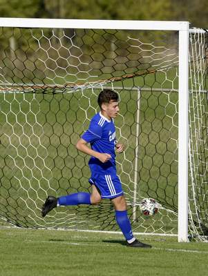 Photos by Rachel Von Stroup | The Journal Gazette Carroll's Chase Hartzog kicks one of his two goals into the net during the Chargers' sectional match Wednesday afternoon against Snider at DeKalb.