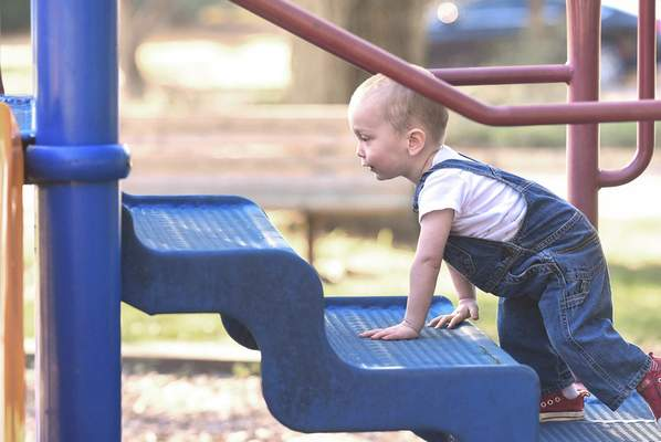 Michelle Davies | The Journal Gazette Sunny Strack, 2, explores the playground equipment at Northside Park Wednesday morning.