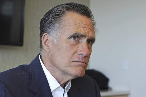 Sen. Mitt Romney, R-Utah, listens to reporters following a roundtable discussion at Intermountain Primary Children's Hospital with officials and health experts to receive an update on anti-vaping efforts Thursday, Oct. 10, 2019, in Salt Lake City. (AP Photo/Rick Bowmer)