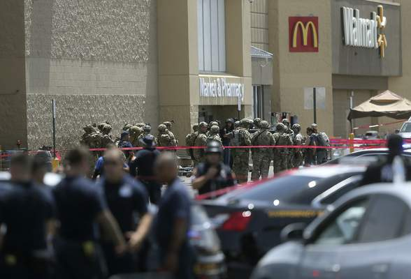 FILE - In this Aug. 3, 2019, file photo, several law enforcement agencies respond to an active shooter at a Walmart in El Paso, Texas. (Mark Lambie/The El Paso Times via AP, File)