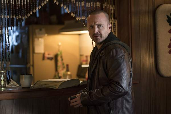 This image released by Netflix shows Aaron Paul in a scene from