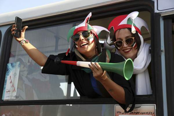Iranian women cheer as they arrive to the Azadi Stadium to watch the 2022 World Cup qualifier soccer match between Iran and Cambodia, in Tehran, Iran, Thursday, Oct. 10, 2019. (AP Photo/Vahid Salemi)