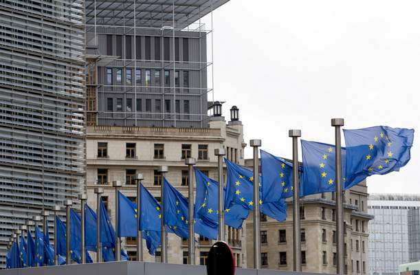 European Union flags flap in the wind at EU headquarters in Brussels, Wednesday, Oct. 9, 2019. (AP Photo/Virginia Mayo)