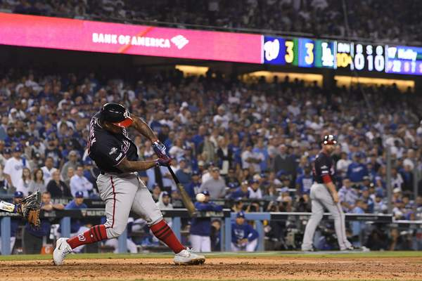 Associated Press  Washington Nationals' Howie Kendrick hits a grand slam against the Los Angeles Dodgers during the 10th inning in Game 5 of a baseball National League Division Series on Wednesday, in Los Angeles.