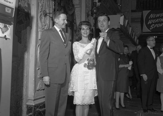 Jan. 27, 1962: Fort Wayne actor Jack Morey, left, stands with Night of Evil stars Lisa Gaye and William Campbell in the lobby of Embassy Theatre. (Journal Gazette file photo)