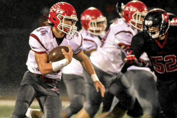 Mike Moore   The Journal Gazette Adams Central running back Blake Heyerly carries the ball in the first period against Bluffton at Bluffton High School on Friday.