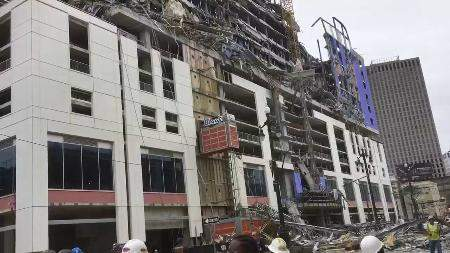 Courtesy WWL-TV via Associated Press: This photo provided by WWL-TV shows several construction standing after a large portion of the Hard Rock Hotel, under construction, suddenly collapsed Saturday in New Orleans.