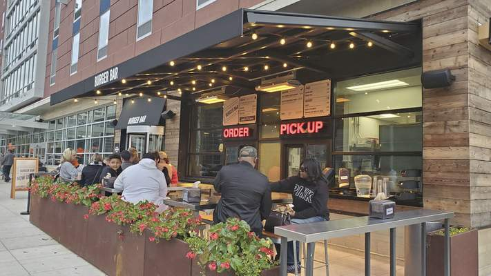 The outdoor patio and ordering window at Burger Bar in the Hampton Inn & Suites downtown.
