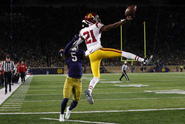 Southern California wide receiver Tyler Vaughns (21) tries unsuccessfully to catch a pass as Notre Dame cornerback Troy Pride Jr. (5) defends in the second half of an NCAA college football game in South Bend, Ind., Saturday, Oct. 12, 2019. (AP Photo/Paul Sancya)