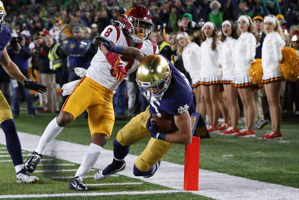 Notre Dame wide receiver Braden Lenzy (25) scores a touchdown on a 51-yard run as Southern California cornerback Chris Steele (8) defends in the first half of an NCAA college football game in South Bend, Ind., Saturday, Oct. 12, 2019. (AP Photo/Paul Sancya)
