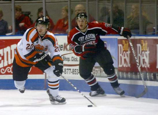 Clint Keller | The Journal Gazette: Steven Oleksy, seen here for Port Huron losing the puck to Komet Bobby Phillips in a 2009 game at Memorial Coliseum, has been signed by the Toledo Walleye.